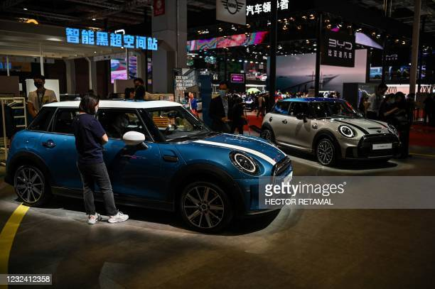 Mini cars are seen during the 19th Shanghai International Automobile Industry Exhibition in Shanghai on April 20, 2021