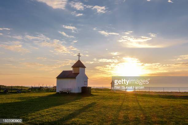 a mini chapel at the graveyard at unstad in lofoten islands norway - finn bjurvoll stock pictures, royalty-free photos & images