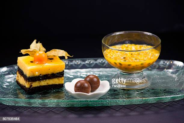 Mini chocolate cake, truffles and pulp of passion fruit