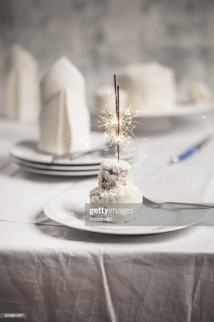 Mini Coconut Birthday Cake With Sparklers On Plate Stock Photo
