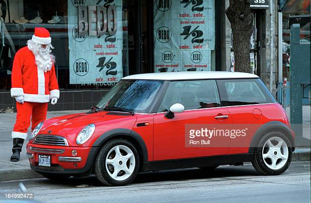 Mini Cooper 12/18/01The brand new Mini Cooper draws onlookers on Queen St