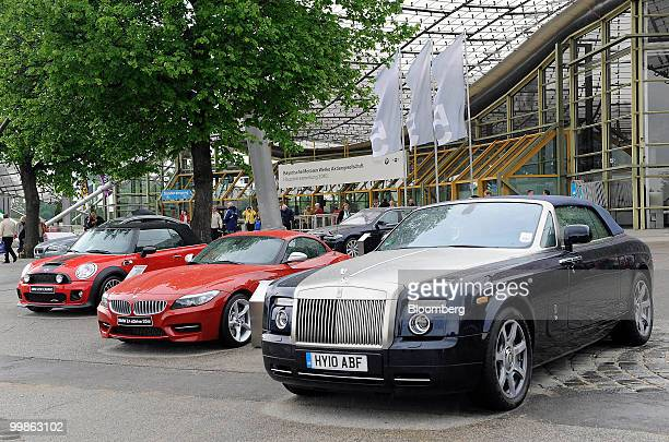 Mini Cooper BMW Z4 and RollsRoyce automobiles left to right are seen outside the Bayerische Motorenwerke annual shareholders' meeting in Munich...