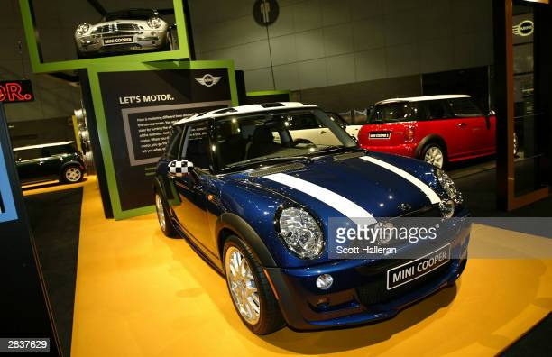 Mini Cooper cars are displayed prior to the start of the 2004 Greater LA Auto Show at the Los Angeles Convention Center December 30 2003 in Los...