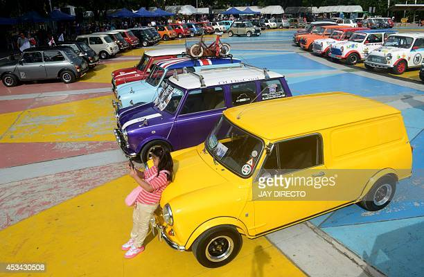 Mini Cooper cars are put on display in a public park in a suburb of Manila on August 10 uniting Mini owners in the Philippines in cooperation with...