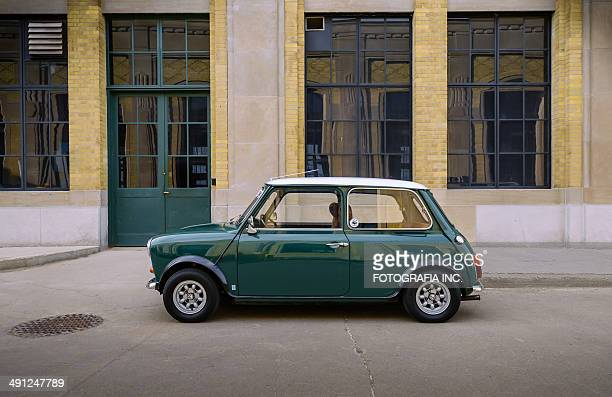 mini cooper classic in spring time - mini cooper stock pictures, royalty-free photos & images
