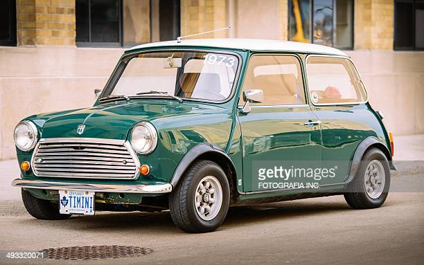 mini cooper classic in spring time - mini cooper stock photos and pictures