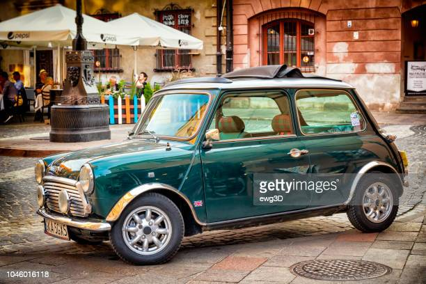mini cooper classic in warsaw's old town - mini cooper stock pictures, royalty-free photos & images