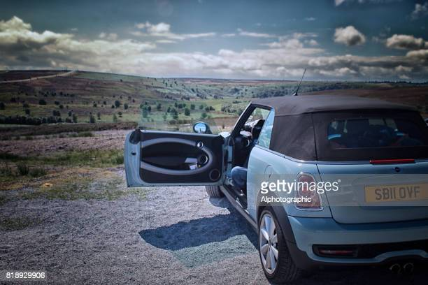 mini cooper convertible overlooking yorkshire dales - mini cooper stock pictures, royalty-free photos & images