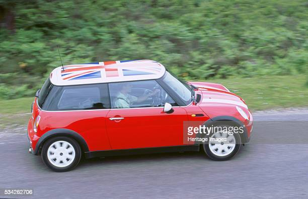 Mini Cooper driving on country road 2000