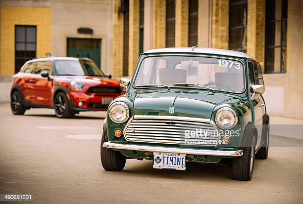 mini cooper generations in spring time - mini cooper stock pictures, royalty-free photos & images