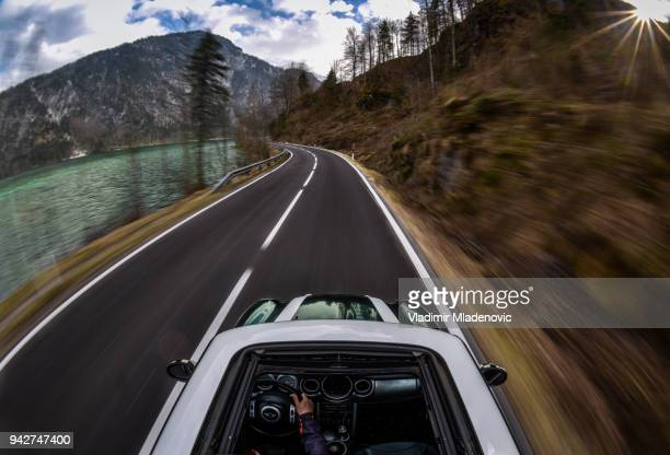 mini cooper in motion - mini cooper stock pictures, royalty-free photos & images