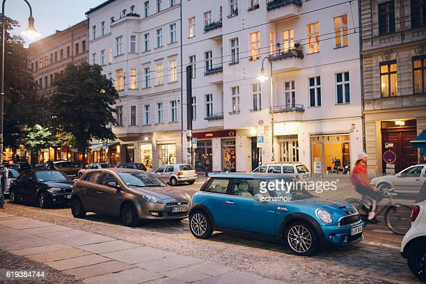 mini cooper on the streets of berlin - prenzlauer berg stock photos and pictures