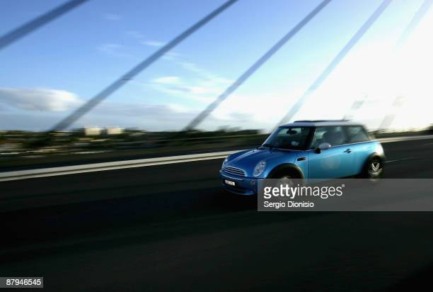 Mini Cooper owners drive over the Anzac Bridge during the 50 year celebration of the Mini in Australia on May 24 2009 in Sydney Australia This...