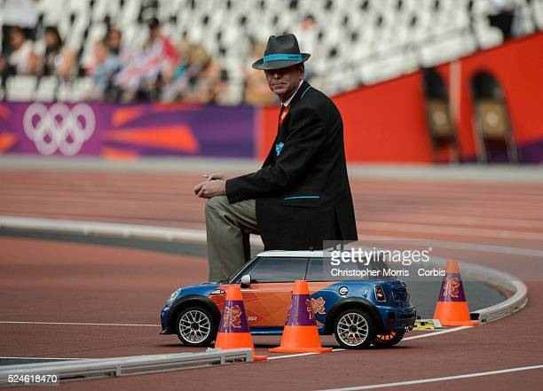 Mini Cooper remote control car and judge Athletics Day 13 Track and field at the Olympic Stadium during the 2012 London Olympic Games