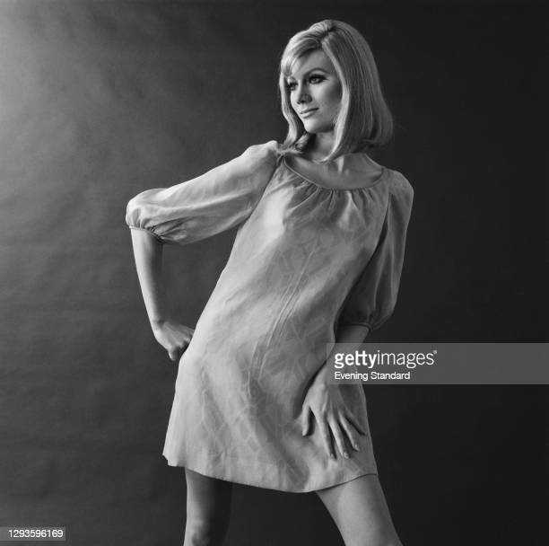 Mini dress in a geometric fabric, with full sleeves and round neckline, UK, 13th March 1967.