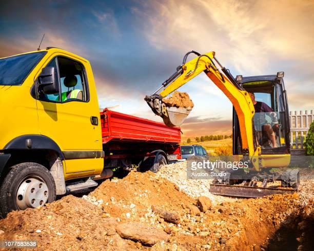 miniescavadora - excavator - fotografias e filmes do acervo