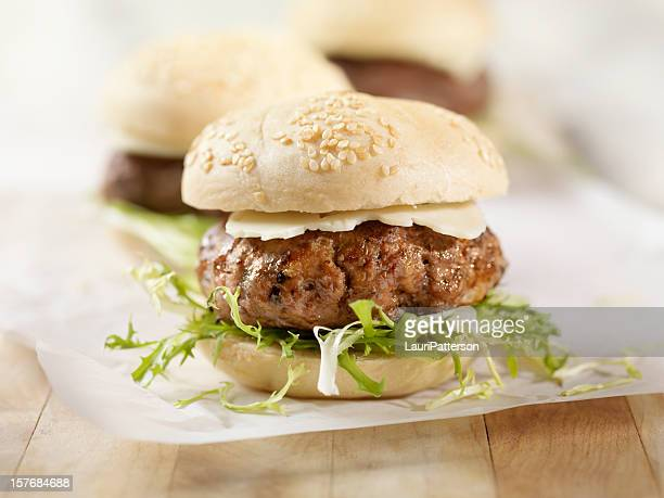 mini hamburger with havarti cheese - wax paper stock photos and pictures