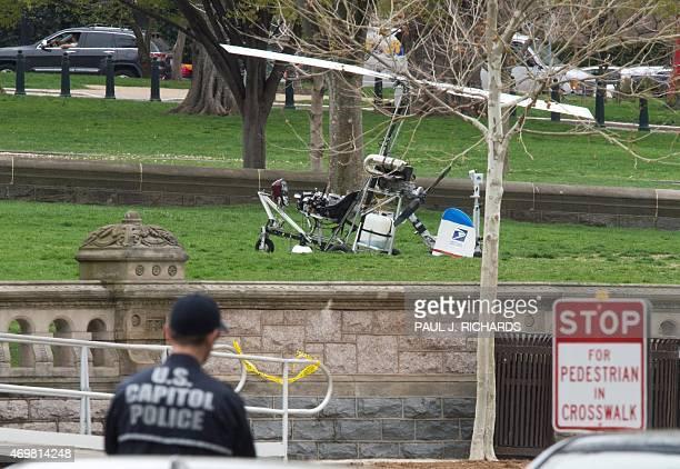 A mini helicopter or gyrocopter that landed on the US Capitol South Lawn area is viewed April 15 in Washington DC A man flying a mini helicopter...