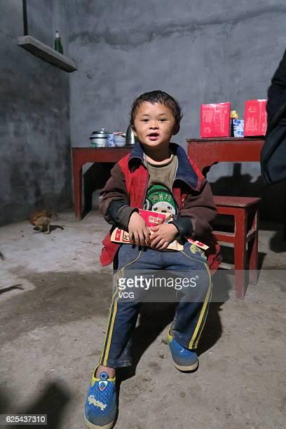 """Mini Jack Ma\"""" Fan Xiaoqin sits at home at Yongfeng County on November 17, 2016 in Ji\'an, Jiangxi Province of China. 8-year-old boy Fan Xiaoqin was..."""