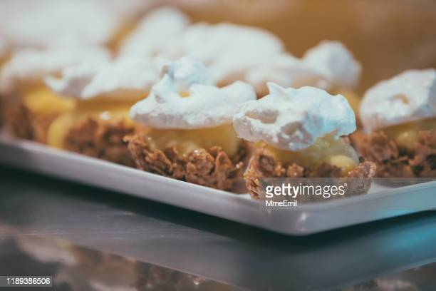 mini lemon pies on a tray - mmeemil stock photos and pictures