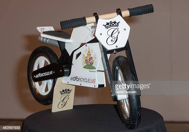 A mini motorcycle given to Prince William Duke of Cambridge as a present for his son Prince George as he visited Motorcylce Live at the NEC Arena on...