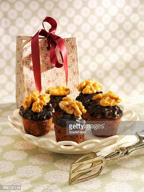 Mini muffins with chocolate icing and walnuts