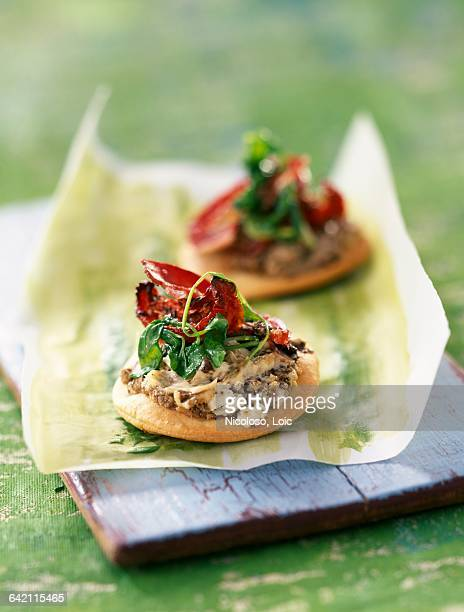 Mini pizzas with fresh goat cheese,tapenade and mayonnaise ( topic : mayonnaise)