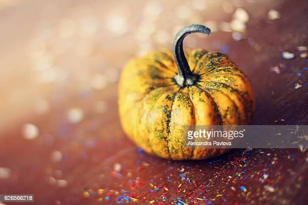 Mini pumpkin and confetti decoration for Halloween