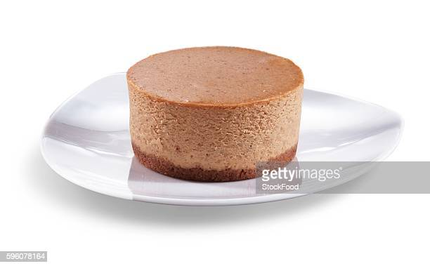 Mini Pumpkin Cheesecake on a White Plate; White Background