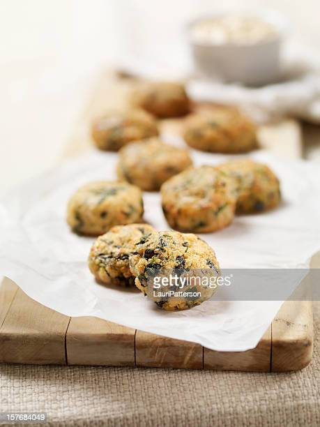 mini salmon cakes with spinach and spicy mayo - wax paper stock photos and pictures