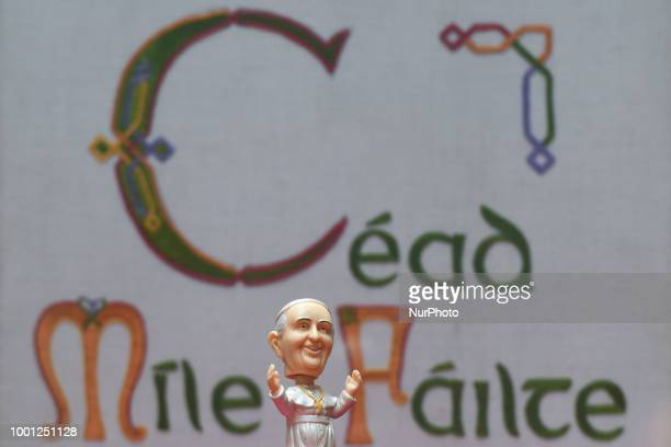 A mini size Pope Francis Bobble head in front of a 'Cead Míle Failte' on display at Dublin's Balla Ban Art Gallery The gallery owner Frank O'Dea will...