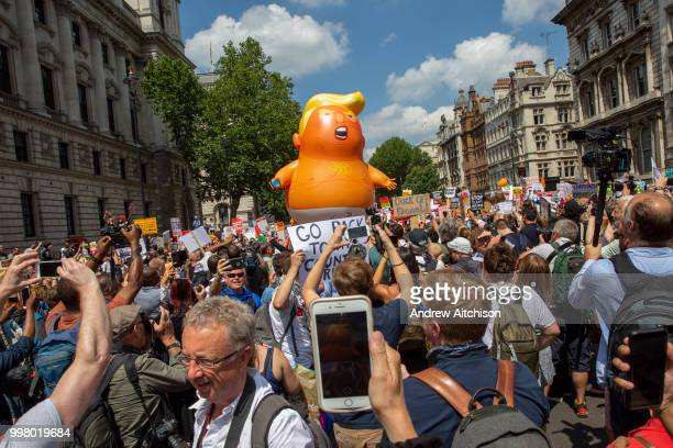 Mini Trump Baby joins the Womens March Against Trump as it arrives in Parliament Square London United Kingdom 13th July 2018