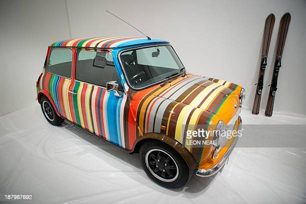 A mini vehicle in the colours of British fashion designer Paul Smith is pictured at an exhibition entitled Hello My Name is Paul Smith at the Design...