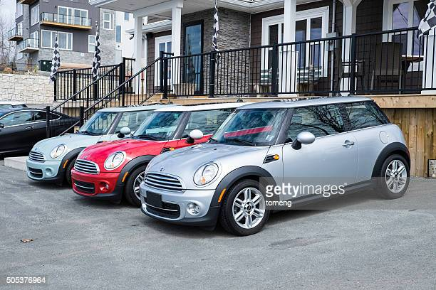 mini vehicles at a car dealership - mini cooper stock photos and pictures