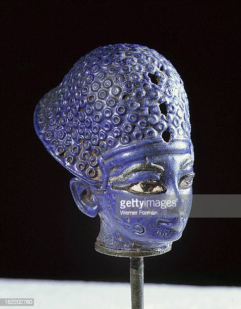 Miniature blue glass paste head of the pharaoh Amenophis III wearing the blue war crown Egypt Ancient Egyptian New Kingdom c 1390 1352 BC