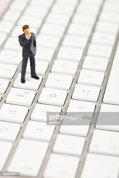 Miniature businessman on a keyboard