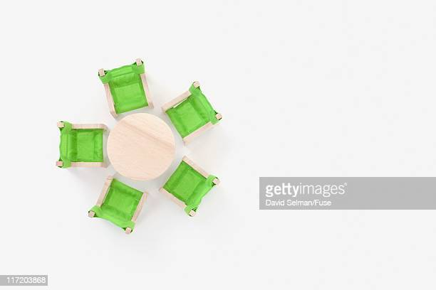 Miniature chairs around a table