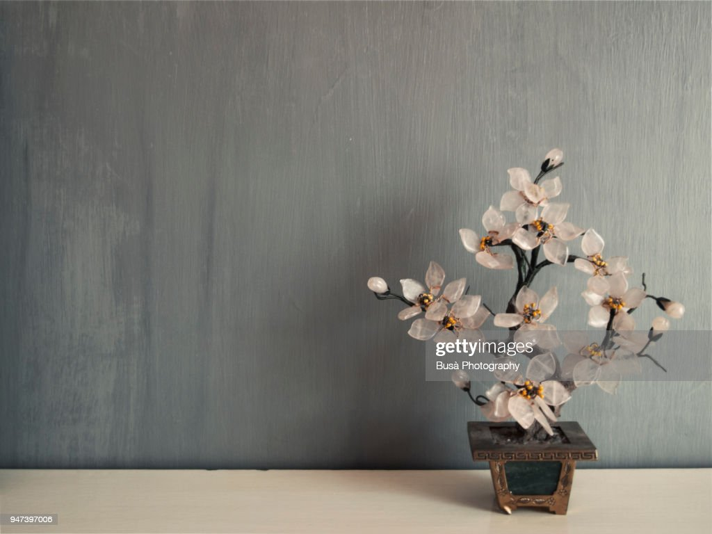 Miniature cherry tree made of glass against a grey background : ストックフォト