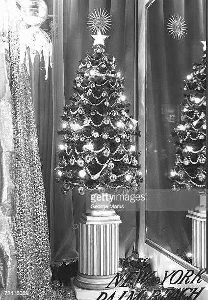 Miniature Christmas tree in shop window, (B&W)