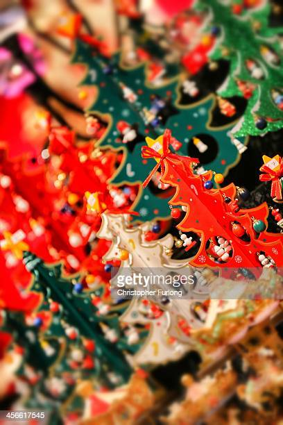 Miniature christmas trees adorn a market stall during Birmingham's Frankfurt Christmas market on December 3 2013 in Birmingham England Birmingham's...
