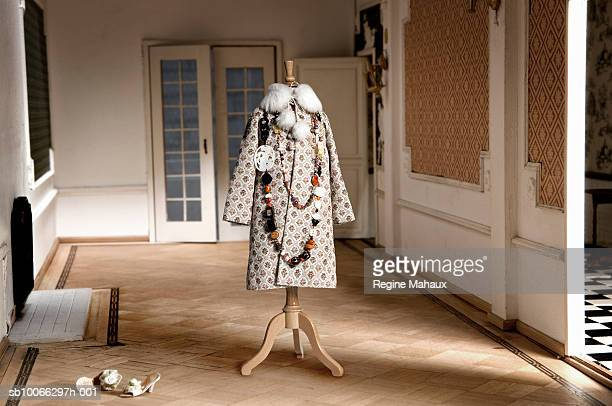Miniature coat on tailor's dummy in doll house living room