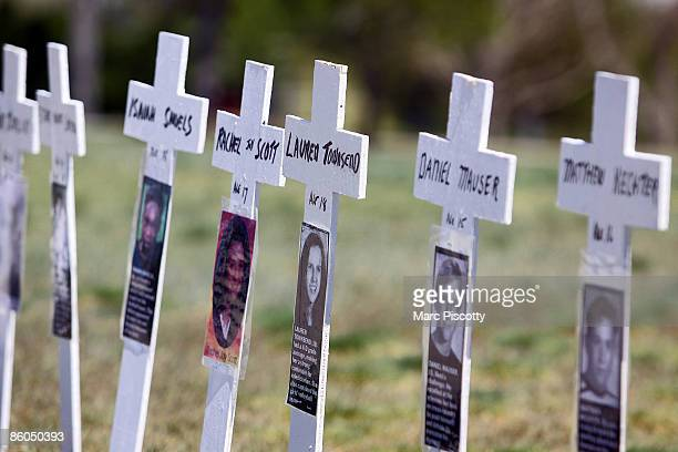 Miniature crosses are displayed to commemorate the tenyear anniversary of the Columbine High School shootings at Clement Park April 20 2009 in...