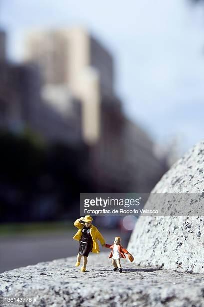 Miniature figures of little people running around