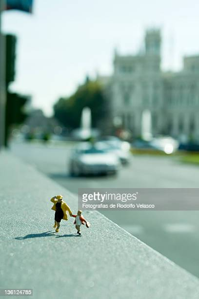 Miniature figures running around city