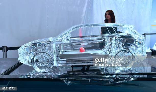 A miniature glass model version of the new Porsche Cayenne on display at the 2017 LA Auto Show on November 29 2017 in Los Angeles California on the...