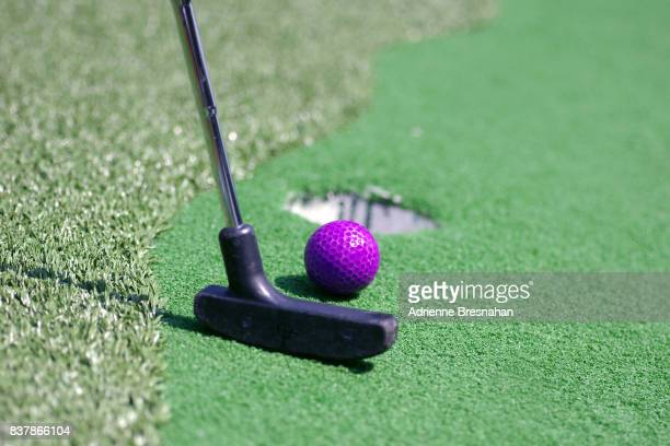 miniature golf, close-up, with purple golf ball - miniature golf stock photos and pictures