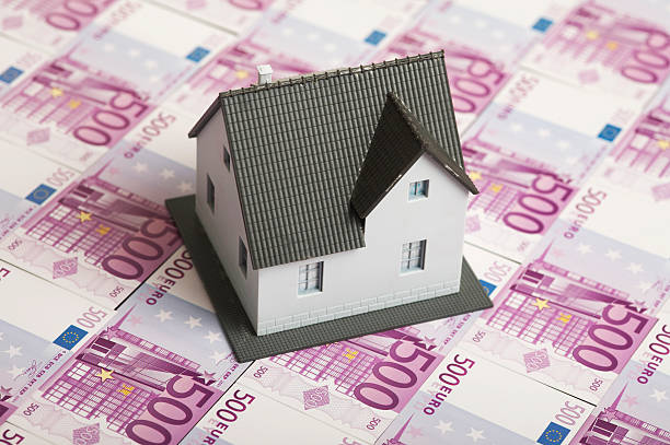 Miniature house on banknotes