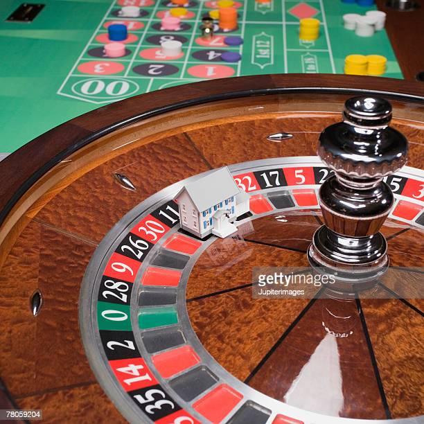 Miniature house on roulette wheel