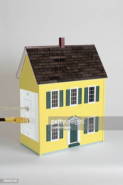 Miniature house with cable outlet