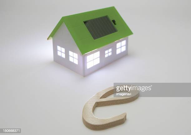 Miniature house with solar panels and 'e